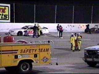 Driver barely escaped very serious injury and is helped by track safety officials